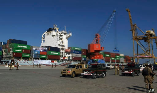 A loaded Chinese ship is readied for departure during a ceremony at Gwadar port, about 435 miles, 700 km, west of Karachi…